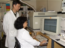 Zhanpin Wu (previously JEOL) and the late Agnes Rimando (USDA) with JEOL GCMate mass spec.